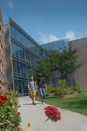 Volgenau students walk by the Nguyen building